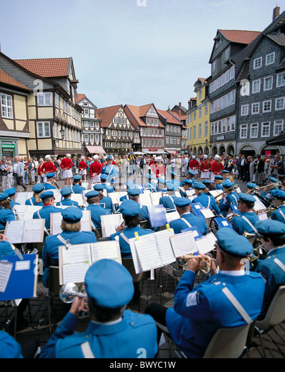 Old Town Germany Europe half-timbered houses concert wind music marketplace band Quedlinburg Saxon Anhalt - Stock Image