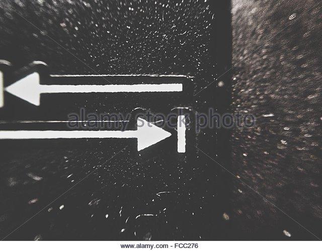 Macro Shot Of Arrow Signs - Stock Image
