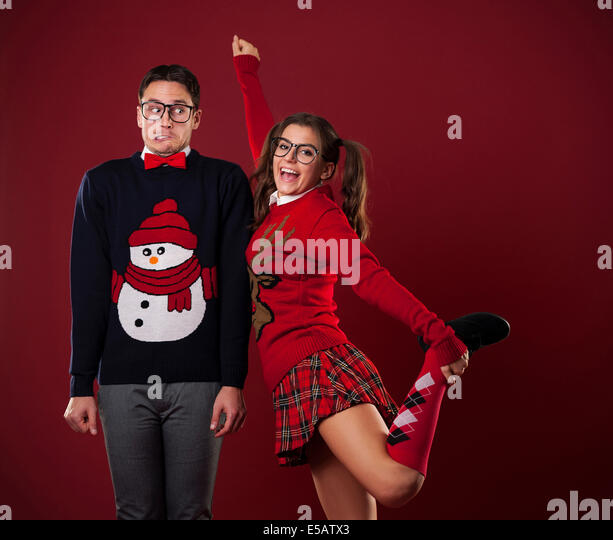 Nerdy women flirting with shy man Debica, Poland - Stock Image