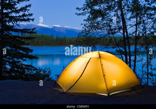Tent and Boya Lake at dusk, Boya Lake Provincial Park, Northern British Columbia - Stock Image