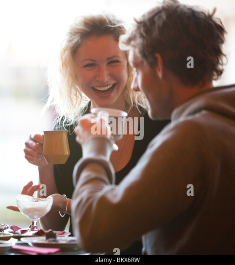 Close up of a young couple sitting in a cafe drinking coffee - Stock-Bilder