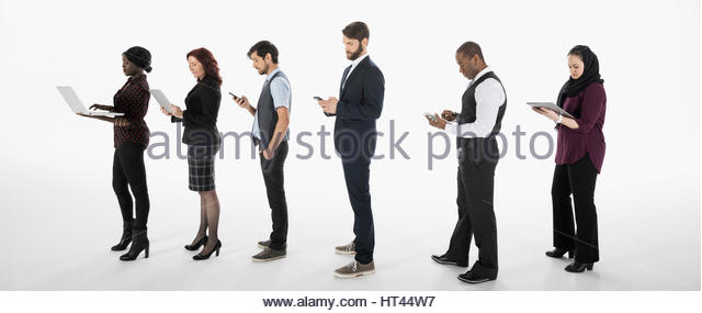 Business people using cell phones, digital tablets and laptop in a row against white background - Stock-Bilder