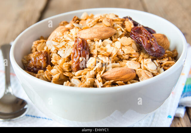 delicious and healthy wholegrain muesli breakfast, with lots of dry fruits, nuts and grains close up, horizontal, - Stock Image
