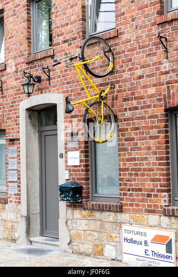 HENRI-CHAPELLE, BELGIUM, 25th JUNE, 2017 - painted bike fixed on a house wall - Stock Image