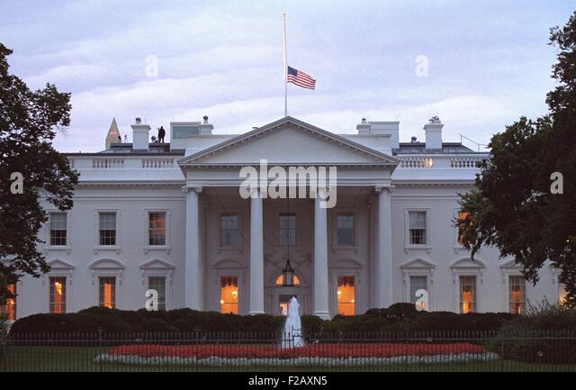 American flag flies at half-staff over the White House at sunrise Friday, Sept. 14, 2001. 3 days following the 9 - Stock Image