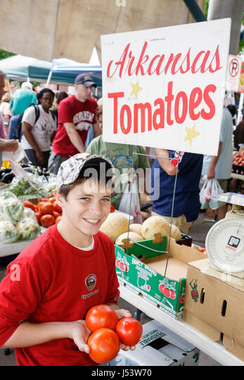 Little Rock Arkansas River Market Farmers Market locally grown produce buyers sellers boy red tomatoes Lycopersicon - Stock Image