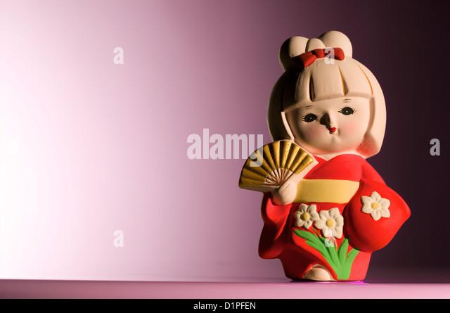 Japanese figurine wearing a Kimono - Stock Image