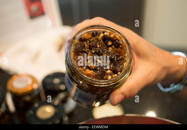 Female cook making mincemeat for a Christmas pudding - Stock Image