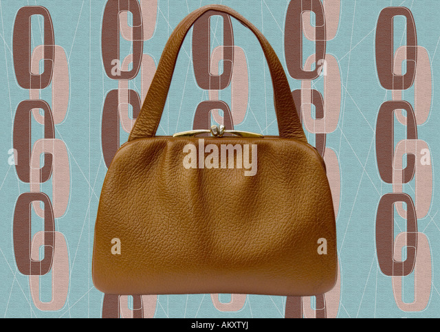 1940's vintage handbag shot against a wallpaper style background - Stock Image