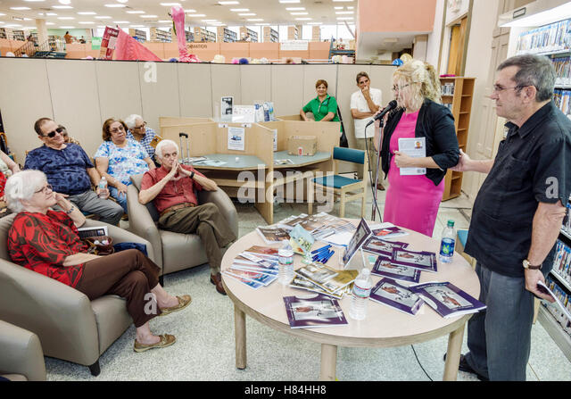 Miami Florida Hialeah JFK Library Health and Literacy Fair interior audience listening local poet author speaking - Stock Image