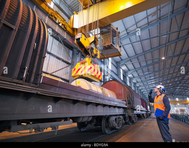 Port Worker Loading Cargo On To Train - Stock Image