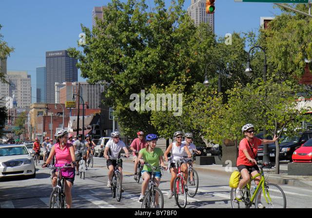 Atlanta Georgia Auburn Avenue bicycle group ride cyclist cycling exercise fitness recreation helmet safety man woman - Stock Image