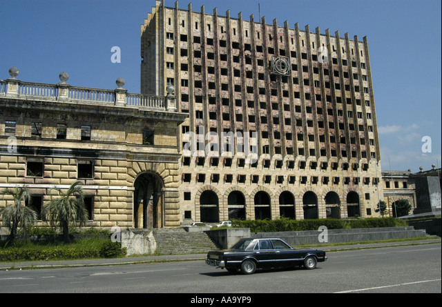 Destroyed building of the Government of Sukhumi (Abkhazia) - Stock Image