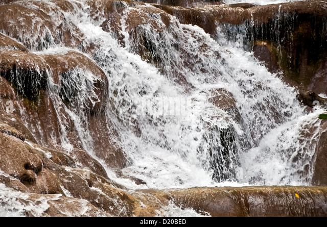 Dunns River Falls closeup rushing waterfall, national symbol of Jamaica, Ocho Rios Jamaica - Stock Image