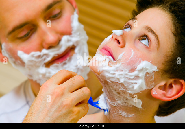Father and son shaving - Stock Image