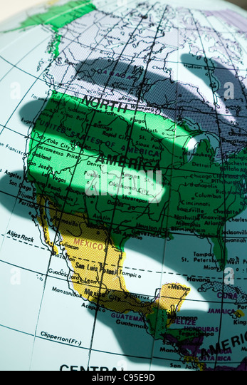 map and the shadow of hand, concept of terrorism - Stock Image