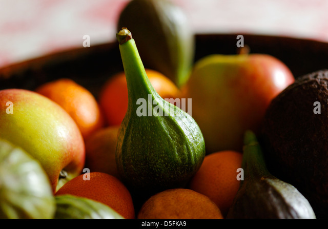 Bowl of fruit with green fig in focus, France - Stock Image