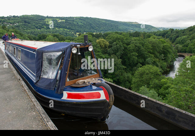 A narrowboat crossing the Pontcysylite Aqueduct on the Llangollen Canal near Trevor in Wales - Stock Image
