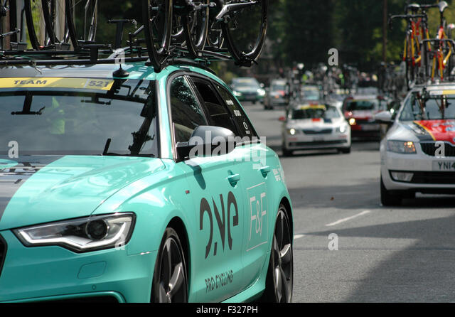Convoy of Support Vehicles for Tour of Britain Cycle Race - Stock Image