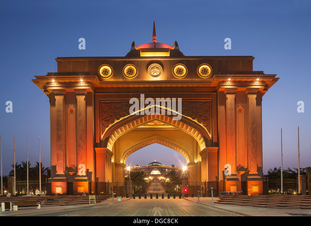 Illuminated entrance to Emirates Palace hotel, Adu Dhabi, United Arab Emirates - Stock Image