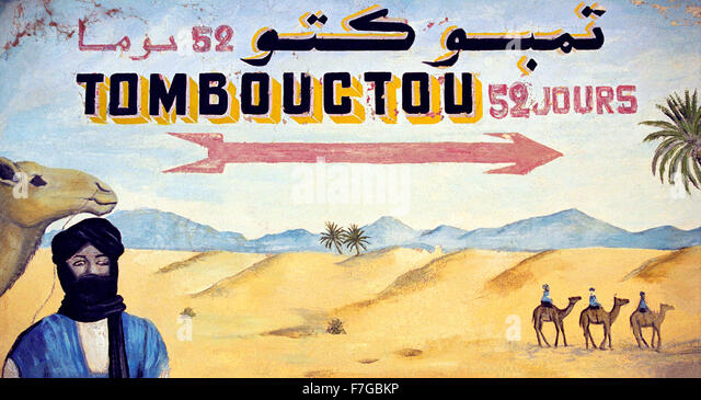 A painted sign of the desert pointing to Timbuktu from Zagora in Morocco, North Africa - Stock Image