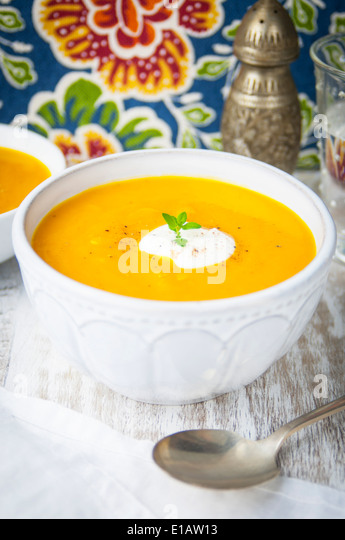 A Close Up of a Bowl of Butternut Squash and Apple Soup - Stock Image
