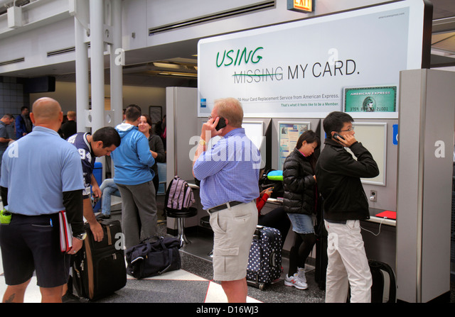 Illinois Chicago O'Hare International Airport ORD concourse gate area passengers American Express lost credit - Stock Image