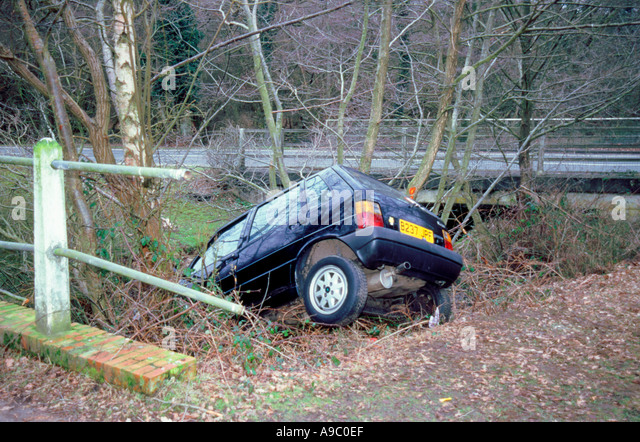 Fiat Uno crashed in to ditch - Stock Image