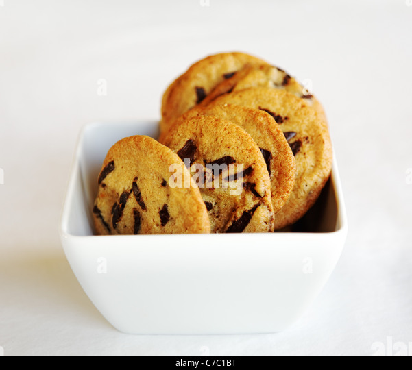 Chocolate chip cookies in white bowl, by pastry chef Laurie Pfalzer, Pastry Craft - Stock Image