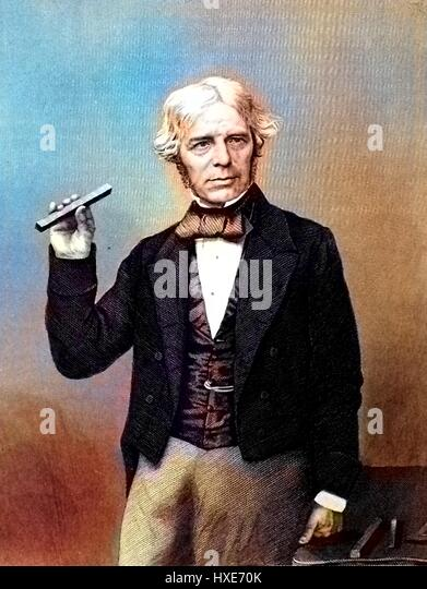 Portrait photograph of scientist Michael Faraday holding a scientific instrument and posing with his hand on a table, - Stock Image
