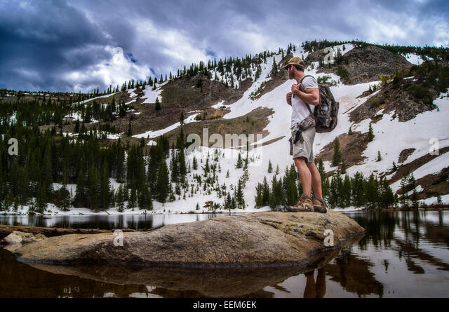 USA, Colorado, Indian Peaks Wilderness, Hiker looking at view - Stock Image