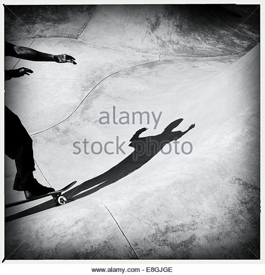 Shadow of a man skateboarding - Stock Image