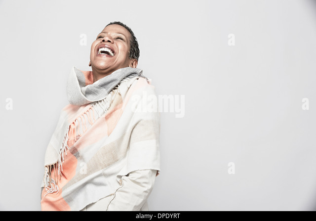 Studio portrait of mature woman laughing - Stock Image