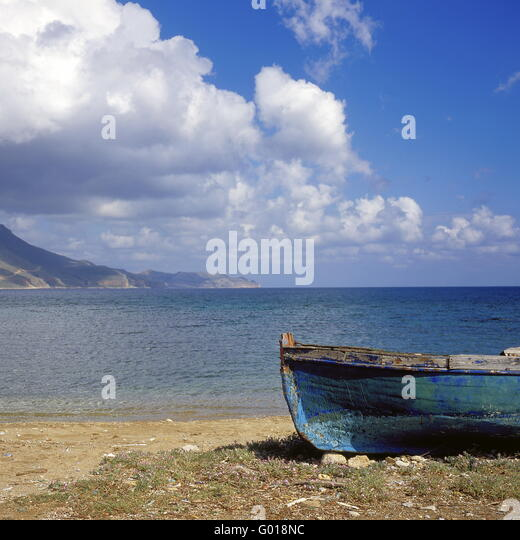 fishing boat at the beach o fCrete Island, Greece - Stock Image