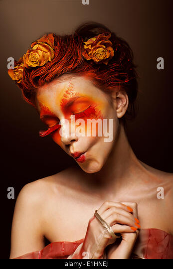 Grimace. Humorous Funny Woman with Flowers having fun. Theatrical Style - Stock Image