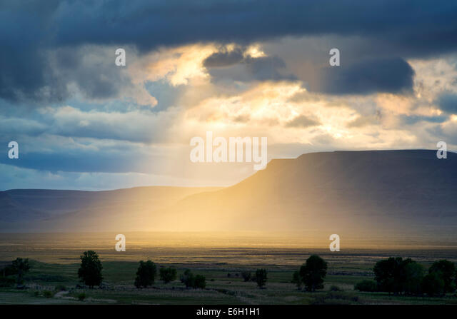 Sunburst through clouds in Harney County, Oregon. - Stock Image