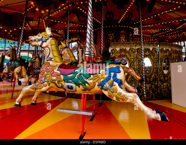Carousel horse on the beach at Brighton, Sussex, UK - Stock Image