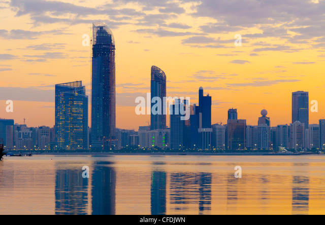 City skyline at dawn, Abu Dhabi, United Arab Emirates, Middle East - Stock Image