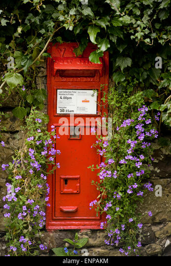 Victorian wall mounted post box in the small Scottish hamlet of Horndean in the Scottish Borders. - Stock Image