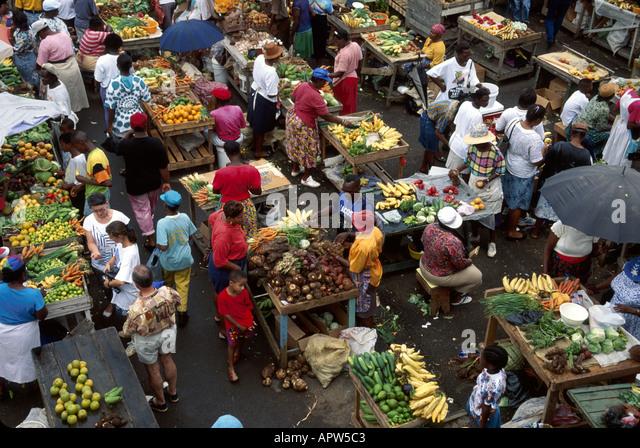 Grenada St. George's Market Square produce vendors shoppers - Stock Image