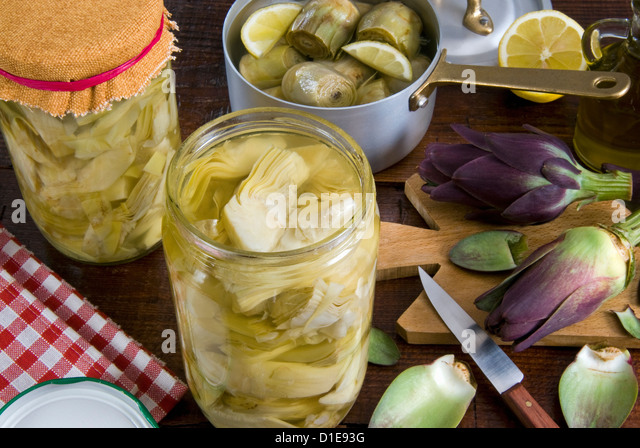 Pickled artichokes in a jar, Italy, Europe - Stock Image