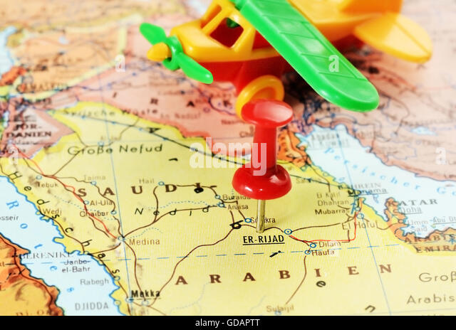 Close up of  Er Riyadh,Saudi Arabia   map with red pin and airplane toy - travel concept - Stock Image