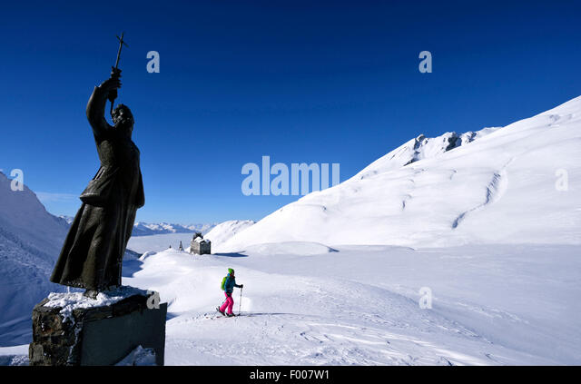 ski touring near the statue of Pierre Chanoux at Little St Bernard Pass, France, Savoie - Stock Image