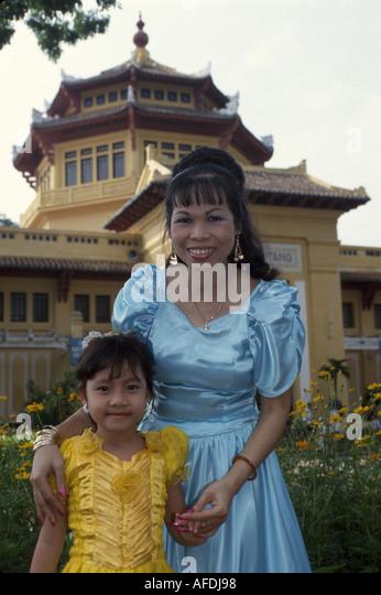 Vietnam Saigon Ho Chi Minh City Historical Museum built 1928 wedding guests woman girl - Stock Image