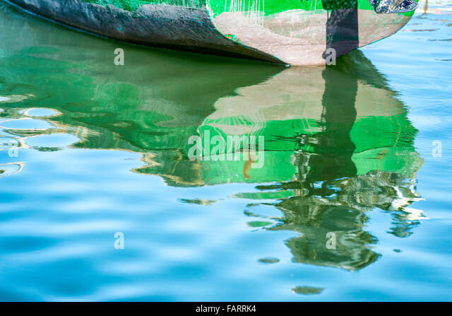 Boat with reflection in water. - Stock Image