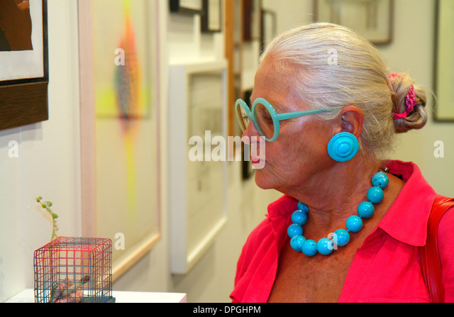 Miami Beach Florida Convention Center centre Art Basel event gallery Galerie 1900-2000 Paris senior woman looking - Stock Image