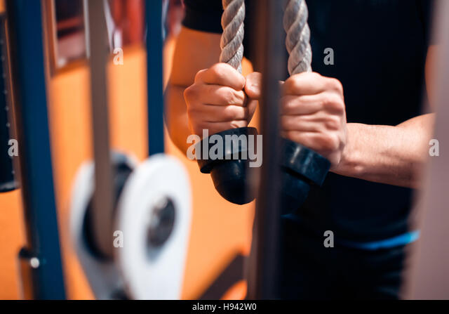 Triceps Exercise With Cables - Stock Image