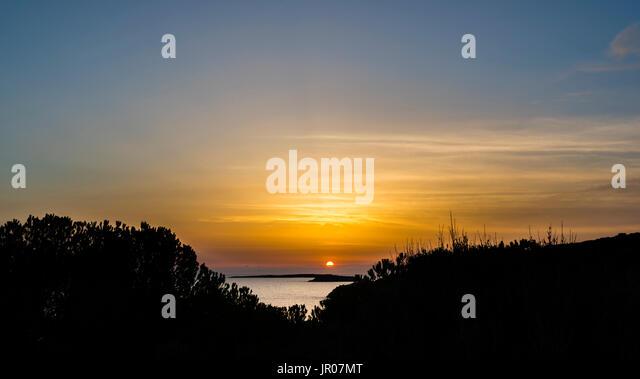 Fabulous orange sunrise over Sardinia, Italy - Stock Image