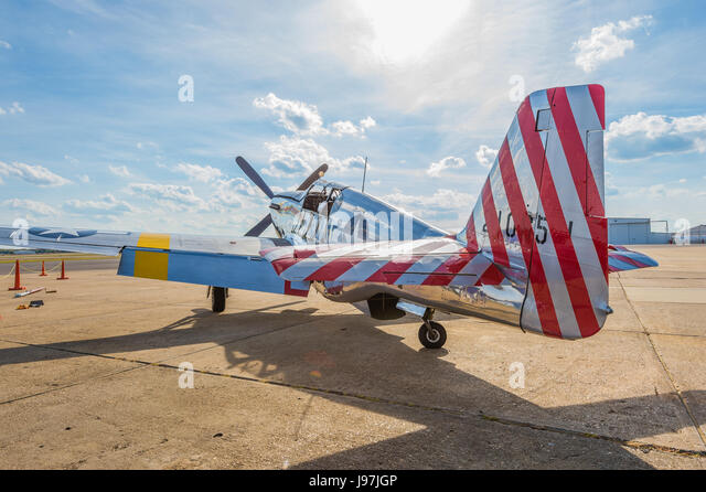 Parked vintage American P-51 Mustang fighter airplane from WWII era. - Stock Image
