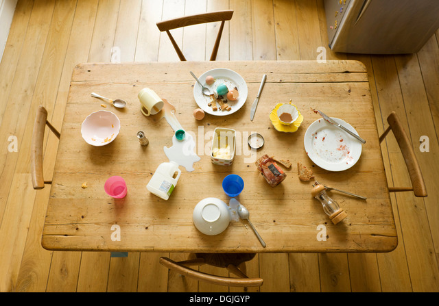 Overhead view of breakfast table with eaten food and messy plates - Stock-Bilder